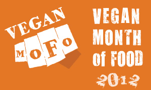 "Orange rectangle with the white fist-shaped Vegan MoFo logo and the text ""Vegan Month of Food 2012."""
