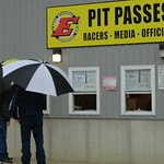 Two fans brave the elements and get their pit passes purchased on Friday afternoon