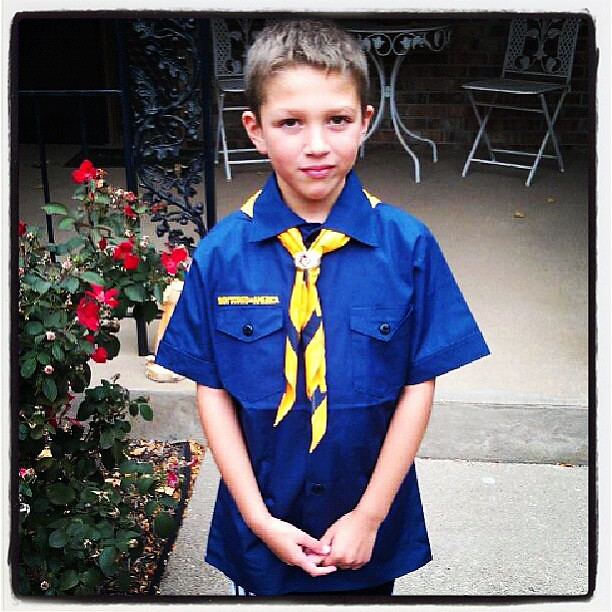 He is now an official scout! I thought he didn't seem to thrilled with the shirt, but he said he liked it. Not sure what is up with the face then