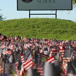 Flags outside Columbia Independent School