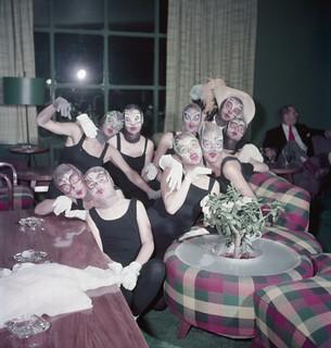 Nine dancers wearing painted masks pose for a photograph at Ste. Adele, Quebec / Neuf danseuses portant des masques paints posent pour un photographe à Ste-Adèle, Québec