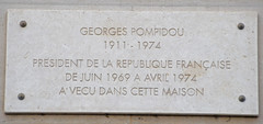 Photo of Georges Pompidou and A. A. Milne grey plaque