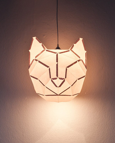 Glowing folded paper cat pendant light