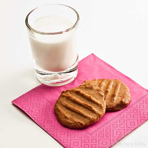 Peanut Butter Cookies on Napkin with Glass of Milk
