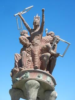 Statues on pedestrian overpass