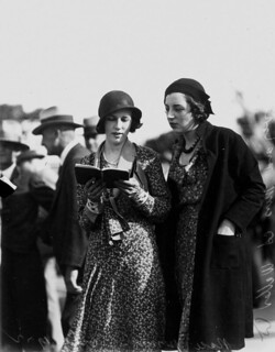 Mrs R Harvey and Miss A Waller picking a winner at Albion Park racecourse, Brisbane, October 1932