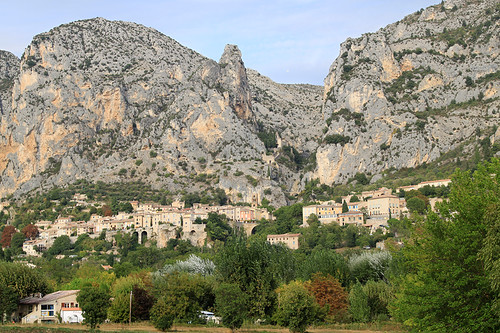 Moustiers-Sainte-Marie perched amongst the limestone cliffs