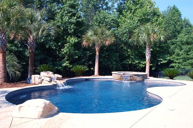 Custom pool and spa with rock waterfall gunite pool for Pool and spa show charlotte nc