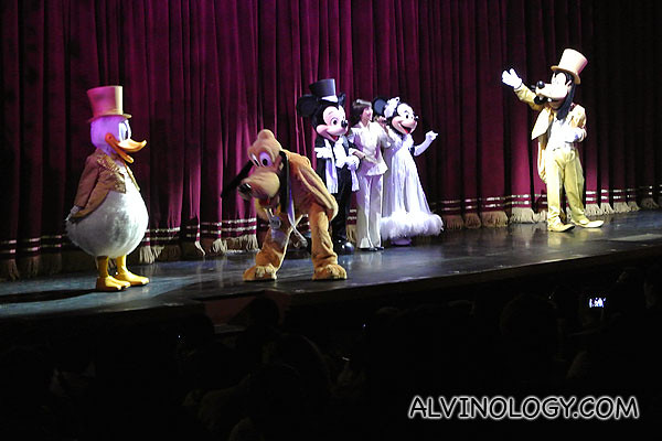 Mickey, Minnie and Donald joins them on stage