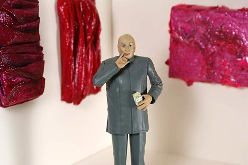 Austin Powers Dr. Evil action figure with miniature paintings by Tiffany Gholar