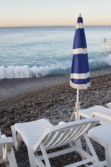 Umbrella and lounge chair on the pebble beach at Nice, France