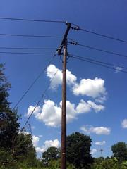 Clouds behind pole