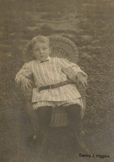 Boy In A Wicker Chair.
