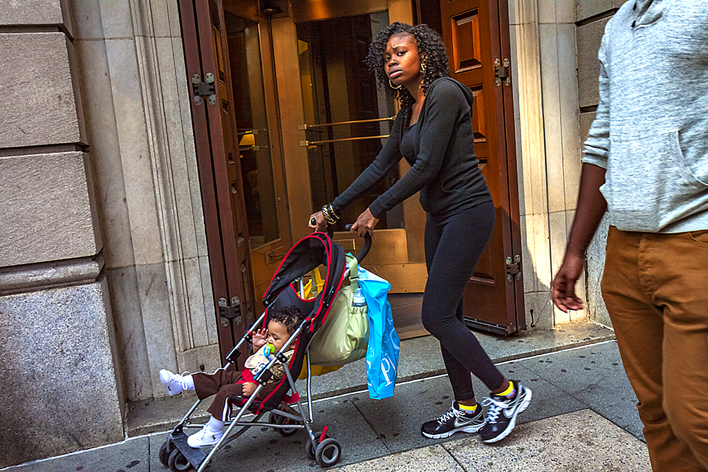 Woman-pushing-stroller-on-9-17-12--Center-City