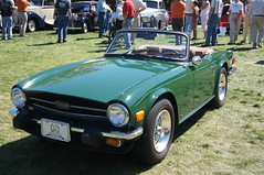 race car, automobile, vehicle, performance car, antique car, classic car, vintage car, land vehicle, triumph tr6, convertible, sports car,