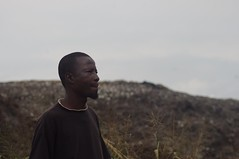 Nouma Camara stands near the Akouedo open-air dumpsite in Abidjan. Camara says the effects of a 2006 toxic waste dumping here still prevent him from working full-time. Credit: Robbie Corey-Boulet/IPS