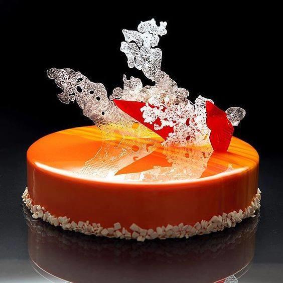 Almond Cake Mousse, Mango, passion fruit jam, crispy base with walnuts, and decoration of isomalt by dinara kasko by Gastronómadas MX
