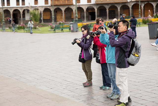 Asian taking a picture of asians taking pictures