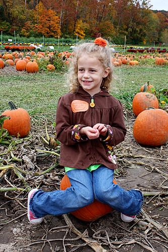 Autumn-sitting-on-pumpkin