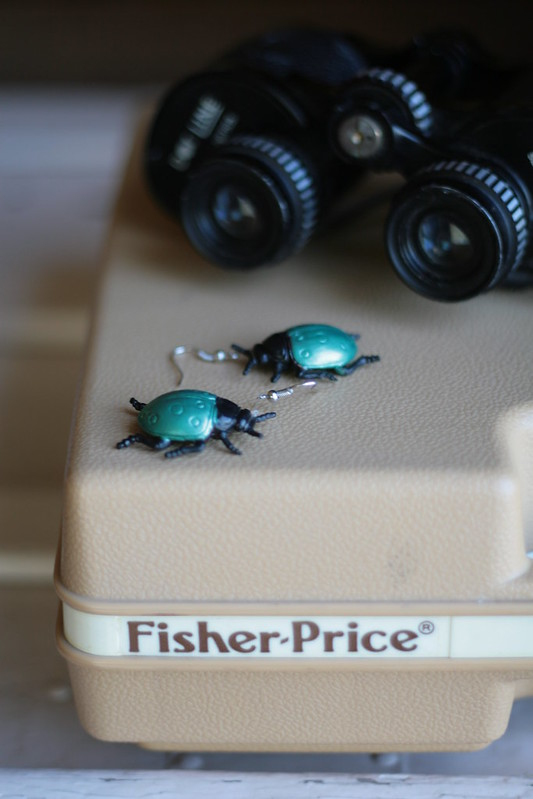 beetle earrings. fisher price record player. binoculars.