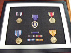 (The Purple Heart, WWII Victory Medal, American Campaign Medal, Asian Pacific Campaign Medal, and the Prisoner of War Medal.)