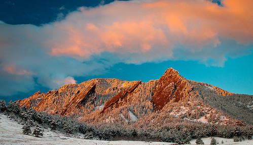 red orange sunrise landscape snowstorm boulder rockymountains frontrange flatirons boulderco chatauquapark colorfulcolorado