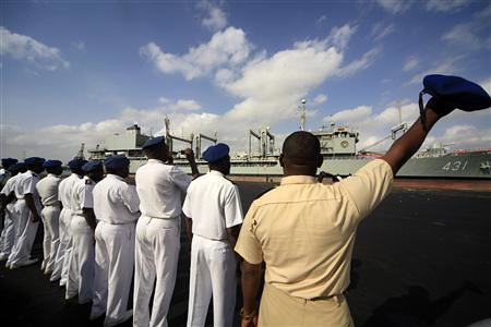 Sudan naval officials wave to Iranian warships as they leave the country. Both nations are under attack by US imperialism and Israel. by Pan-African News Wire File Photos