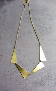 Long gold triangle statement necklace