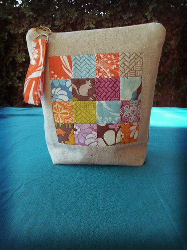 finished my pouch !! I used Kate Spain fabrics and a pattern found on ohfransson.com ...hope my partner likes!!