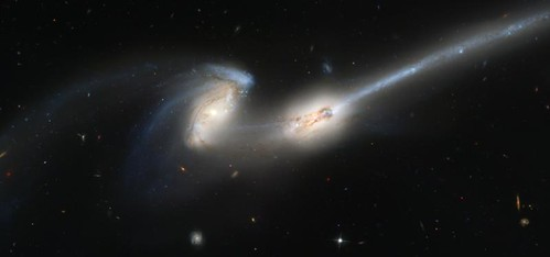 The Mice (NGC 4676): Colliding Galaxies With Tails of Stars and Gas
