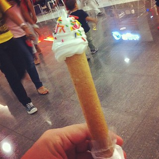 This is a 'frozquillo'. Soft serve vanilla ice cream stuffed into a big barquillo then topped off with a swirl and sprinkles. P30.00 snack!