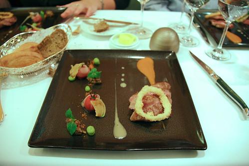 Comme Chez Soi - Pan fried pluma with thyme, lardo di Colonnato,  small truss tomatoes and unpeeled garlic