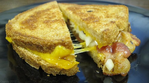 Grilled cheddar, bacon, and onion on wheat by Coyoty