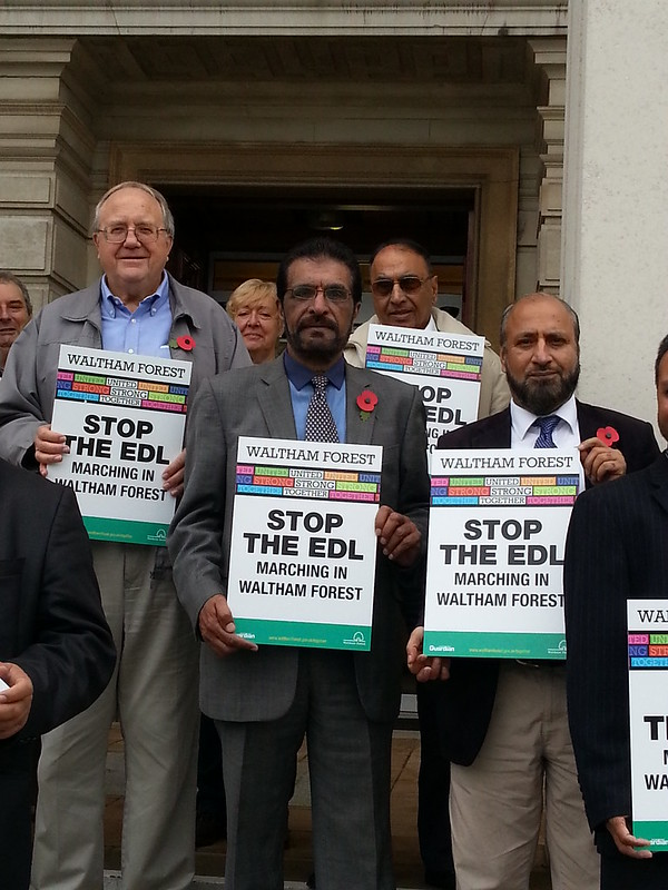Lib Dem Councillors Bob Sullivan, Farooq Qureshi and Mahmood Hussain outside the Town Hall