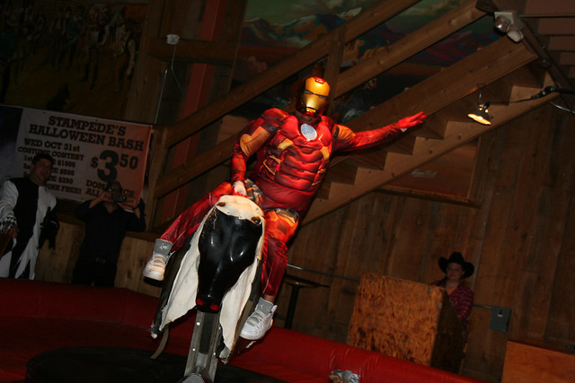 Superhero riding a bull