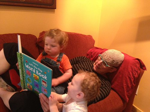 Cousins reading with Grandma
