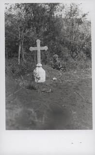 Marine Takes Cover Near Vietnamese Grave, 9 February 1968