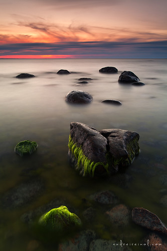longexposure light sunset sea sky orange cloud sun seascape blur color detail green beach nature water colors grass rock vertical stone clouds landscape flow outdoors photography evening coast frozen marine rocks colorful europe soft long exposure estonia slow view outdoor pastel wave atmosphere nopeople baltic fresh clear shore nordic andrei reinol andreireinol