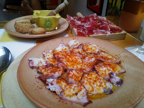 Clockwise from bottom: Pulpo de Gallego, Croquetas de Pollo, and Jamon Iberico de Bellota
