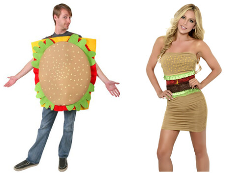 a man and woman both dressed as burgers, but the woman has far fewer items of clothing on