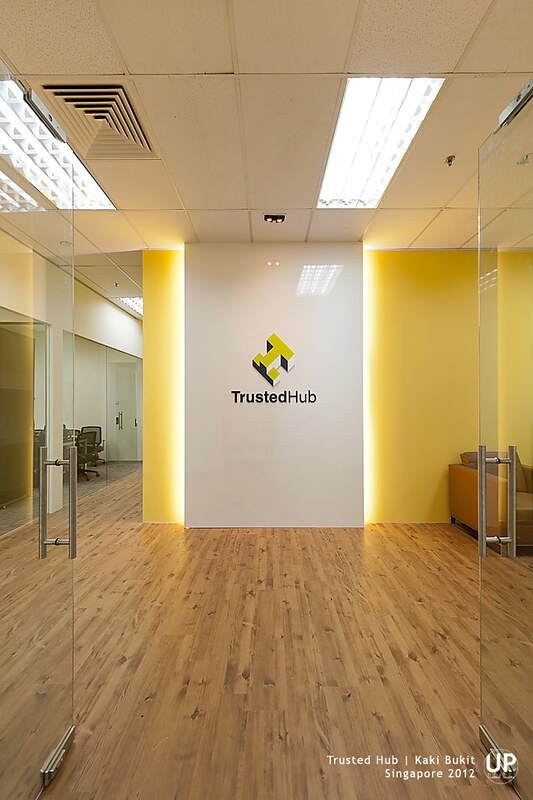 Office Entrance with yellow highlight wall and concealed light behind signage panel