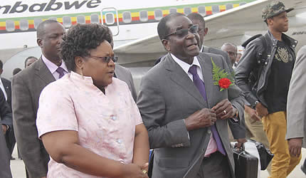 Republic of Zimbabwe Robert Mugabe with Vice President Joice Mujuru at the airport during the president's return from holiday. The photo was taken on January 10, 2013. by Pan-African News Wire File Photos