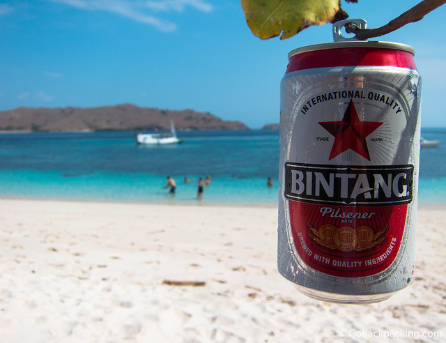 Enjoying a cold Bintang beer on the beach