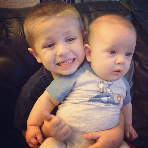 Zachary wanted to hold the baby! #brothers