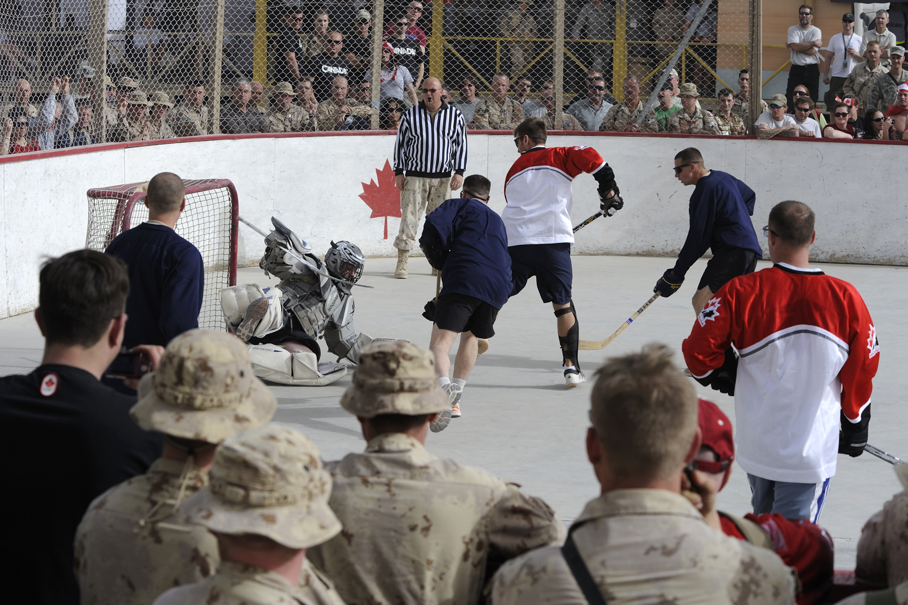 American and Canadian troops play Hockey at Kandahar Airfield, Feb 2010