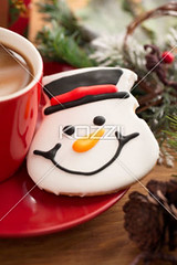 snowman face cookie with hot chocolate