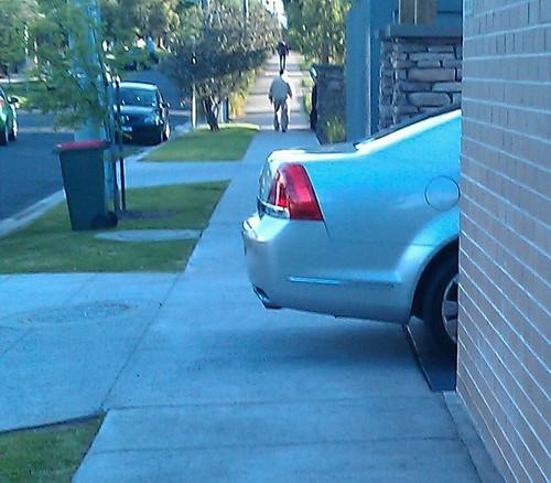 Car illegally blocking footpath