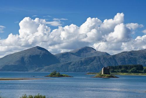 uk blue sea mountains green castle film water clouds landscape island scotland location montypython holygrail grail aaargh stalkerview