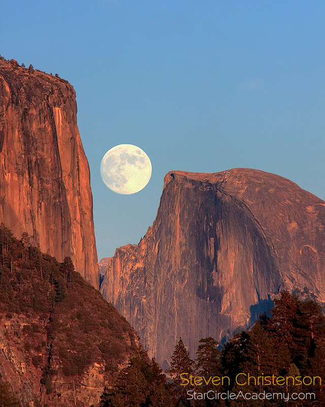 The moon caught between El Capitan and Half Dome - Actual size, no manipulation