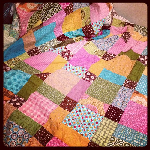 the quilt is finally bound and washed and on my bed!